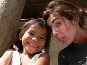 Volunteer and child in Cambodia