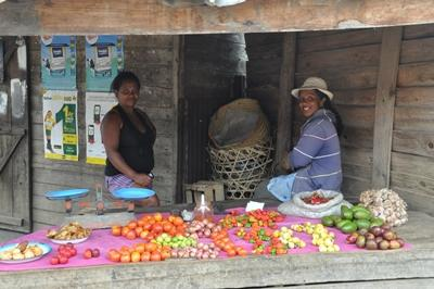 Local women sell their fruit at a market in Madagascar, a Projects Abroad destination