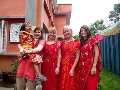 Volunteers in traditional Nepalese clothing