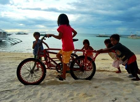 Children on a beach in the Philippines