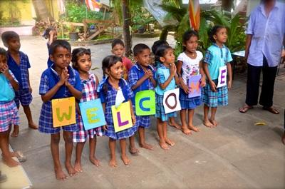 A group of children welcome the new volunteers at Sambuddhaloka