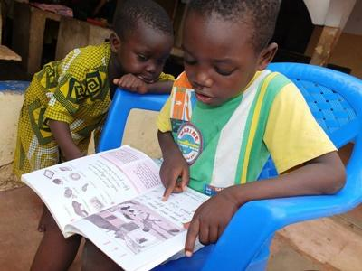 Children from a Projects Abroad Care placement in Togo take part in a Reading Club to help increase literacy