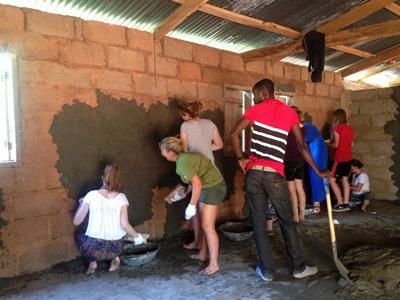 Volunteers help renovate a building in Ghana