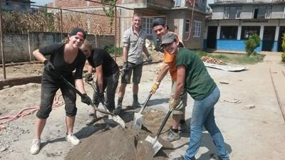 Projects Abroad Disaster Relief volunteers lay foundation for a new classroom in Kathmandu