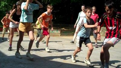 Children playing sports with a volunteer coach at a school in Eastern Europe