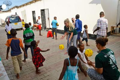 Projects Abroad Care volunteers play with children at an orphanage in Tanzania