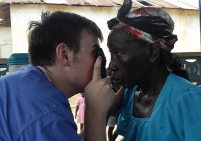 Medical student performs check-up on a patient