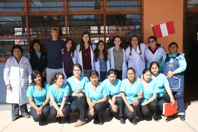 High School Medicine volunteers pose with teachers and nurses following a medical outreach at a primary school in Cusco