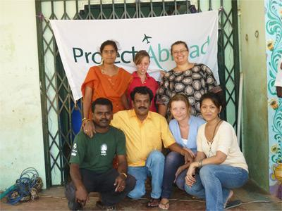 Volunteers with staff members